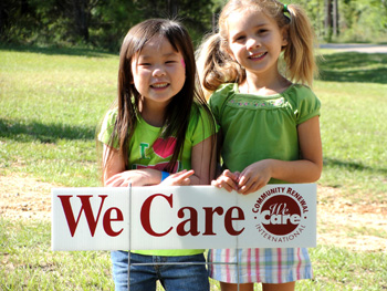 We_Care sign with two girls