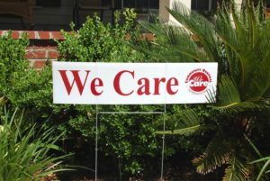We Care yard sign